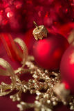 Red and golden xmas ornaments on bright bokeh background Royalty Free Stock Photography