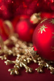 Red and golden xmas ornaments on bright bokeh background Stock Photo