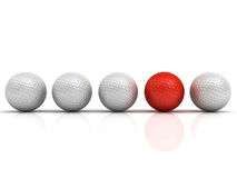 Red golf ball among white golf balls stand out from the crowd concept Royalty Free Stock Photos