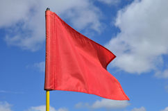 Red Golf Flag. Waving in the Breeze Royalty Free Stock Photo