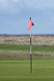 Red golf flag Royalty Free Stock Photo
