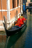Red Gondola. Gondola in the small canals of the romantic Venice Royalty Free Stock Photography