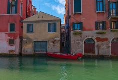 Red Gondola, Venice. Red gondola moored in Venice, Italy Europe Royalty Free Stock Image