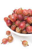 Red gooseberries in a bowl isolated on white Royalty Free Stock Photos