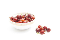 Red gooseberries on a glass dish. Red gooseberries on a dish on white Stock Photo