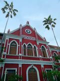 Red Gothic building of Debsirin School. The marvellously restored building of Wat Thepsirin School built in the gothic style , Bangkok , Thailand royalty free stock photo