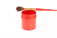 Red gouache paint and brush Royalty Free Stock Photos