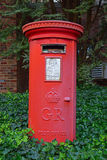 A red GR post box typical in the United Kingdom. Although this picture was taken in New Jersey, USA. The character GR stands for George Rex and Rex means King Royalty Free Stock Images