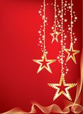Red graded Christmas background with golden stars Stock Photography