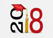 Red 2018 graduation cap and tassel. Red graduation cap on text with gold tassel for class of 2018 on soft white textured background Royalty Free Stock Photos