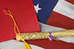 Red graduation cap with US constitution document Royalty Free Stock Photo