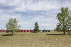 Red grain bins. With trees in foreground Royalty Free Stock Photography