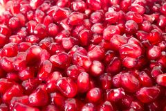 Red grains of pomegranate close-up background texture stock image