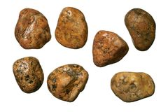 Red granite gravel stones. Red granite round gravel stones. Isolated objects on a white background Stock Photography