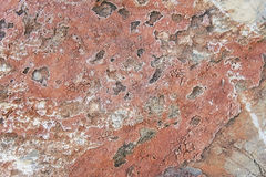 Red granite rock background texture Stock Photos