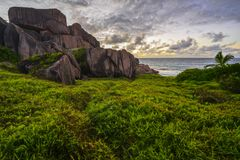 Red granite rocks in the sunrise on la digue on the seychelles 3 Stock Photography