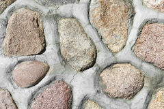 Red granite stones in wall Stock Images