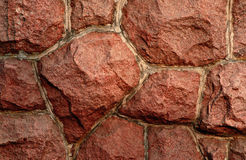 Red granite wall-1. Fragment of a red granite wall Royalty Free Stock Photos