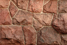 Red granite wall-2. Fragment of a red granite wall Royalty Free Stock Photography