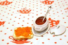 Red granular caviar. In ware and on sandwich Stock Photo