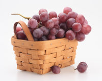 Red grape in the basket. Red fresh organic grape basket pottle isolated Stock Image