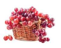 Red grape in basket. Isolated on white background Royalty Free Stock Images