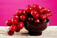 Red grape in bowl Stock Images