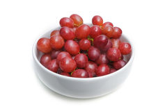 Red grape in a ceramic white bowl Royalty Free Stock Images