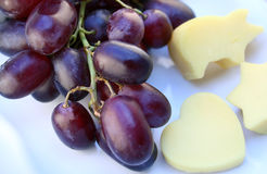 Red grape & cheese Stock Images