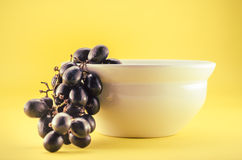 Red Grape with a cup on studio  Royalty Free Stock Images