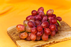 Red Grape on the Cutting Board Stock Photos