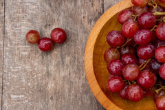 Red grape. Fresh raw red grape on wooden table Stock Photography