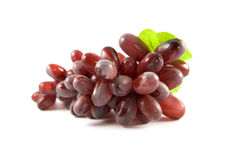 Red grape isolated on white background. With green leaf Stock Image
