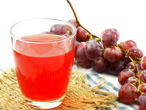 Red grape juice with fruit isolated on white background Royalty Free Stock Photos