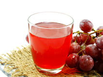 Red grape juice with fruit isolated on white background Royalty Free Stock Images