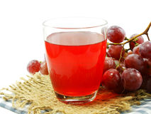 Red grape juice with fruit  on white background Stock Photos