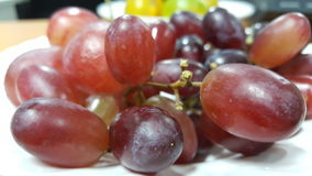 Red grape organic. Grape fruit on disk Stock Images