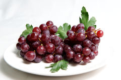 Red grape on plate Royalty Free Stock Images