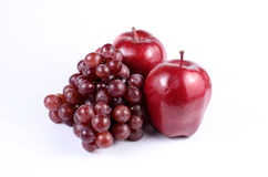 Red grape and red apples. On white background royalty free stock photography