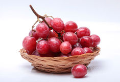 Red grape. Ripe red grape with leaves isolated on white Stock Images