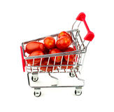 Red grape tomatoes in trolley isolated on white Royalty Free Stock Photo