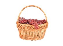 Red grape in a wattled basket Royalty Free Stock Images