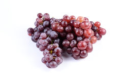 Red grape. On white background stock photography