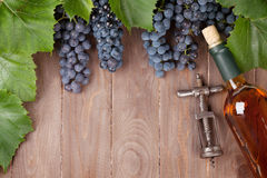 Red grape, wine bottle and vintage corkscrew Royalty Free Stock Photos