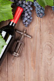 Red grape, wine bottle and vintage corkscrew Royalty Free Stock Photo