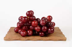 Red grape. On wooden board royalty free stock photo