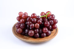 Red grape. On wooden dish stock images