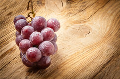 Red grape on wooden table Royalty Free Stock Photo