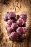Red grape on wooden table Stock Image