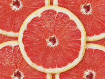 Red grapefruit. Pink (red) cut grapefruit, background Stock Photography